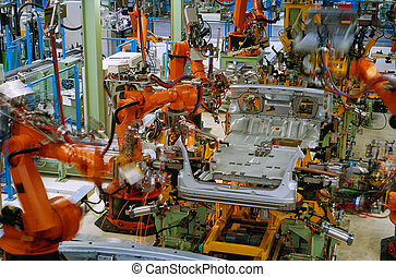 factory - robots welding in a car factory