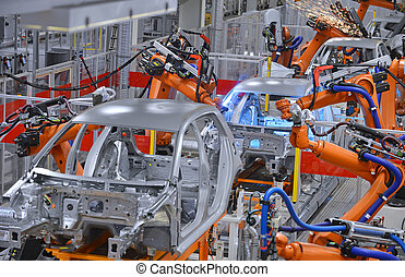 robots welding in factory - robots welding in an automobile ...