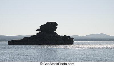 roca, en, el, lago