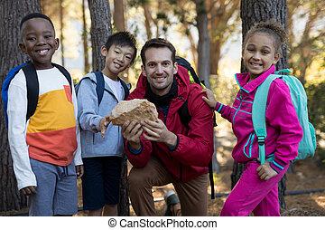 roca, examinar, retrato, niños, profesor