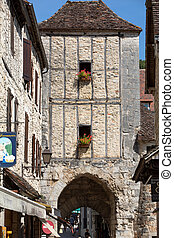 Tourists walking in the medieval centre of Rocamadour. France