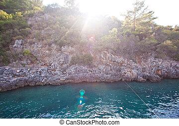rocas, en, el, isla, con, un, hermoso, ocaso