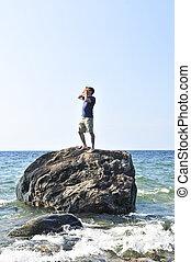 rocher, échoué, homme, océan