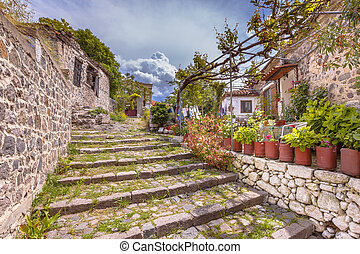 Rock alleyway staircase with gardens on Lesbos island Greece...