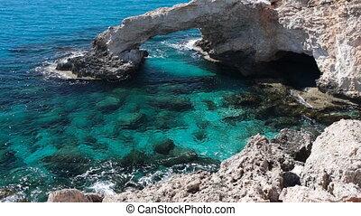 Rock and blue sea. Natural Bridge