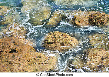 rock and blue water