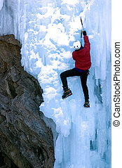 Rock and Ice - adult male climbing snow covered ice next to...