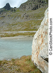 Rock and river in valley in Alps in Switzerland