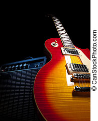 electric guitar with amplifier, over black background, for music and entertainment themes