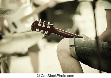 rock and roll - play on guitar, selective focus on center of...