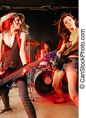 Rock and roll women - Photo of a rock and roll band playing...