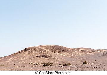 Rock and sand Namib desert landscape near Springbokwasser