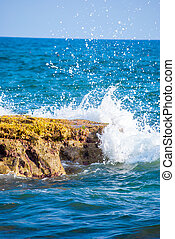 rock and waves in sea