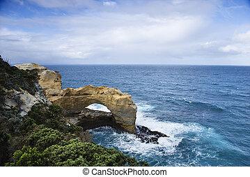 Rock arch in ocean.