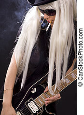 rock babe - woman in top hat with black electric guitar and ...