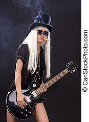 woman in top hat with black electric guitar and cigarette