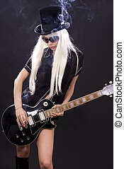 rock babe - woman in top hat with black electric guitar and...