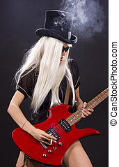 rock babe - woman in top hat with red electric guitar and ...