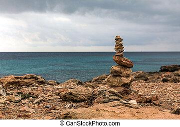 Rock balancing in Ses Saline cap on Majorca island (Balearic...