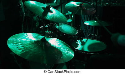 Rock band performing in a nightclub. drummer playing on drum...