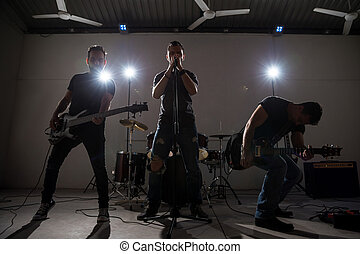 Rock band performs on stage