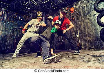 rock boys - Modern dancers dancing in the garage. Urban...