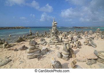 Rock cairns found on Baby Beach in Aruba.