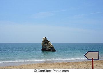 Rock cliff in ocean