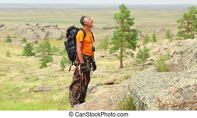 Rock climber - Climber preparing to ascend the rock