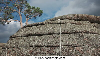 Rock climber climbing on a rock on a rope, Bayanaul,...