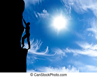rock climber conquering a mountain on the background of sky...