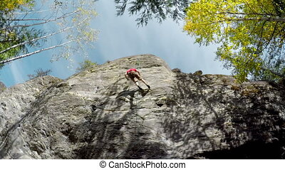 Rock climber descending down from the cliff 4k - Low angle...