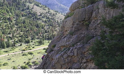 rock climber - female climber climbing mountain