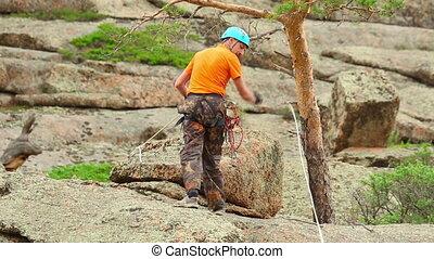 Rock climber - Climber descends down the cliff