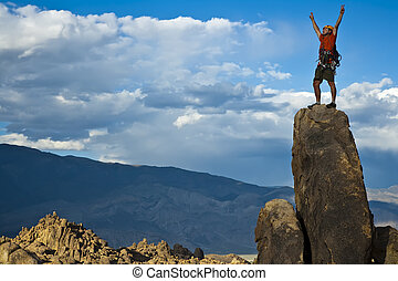 Rock climber nearing the summit. - Climber on the summit of...