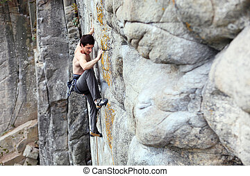 Rock climber on a cliff