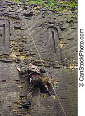rock climber on brick wall