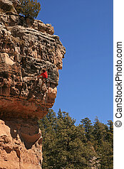 rock climber on cliff