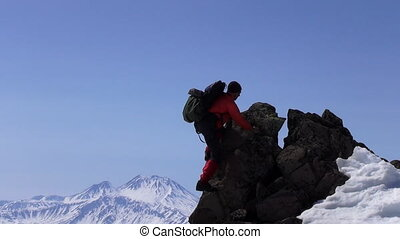 Rock climber on the top of mountain.