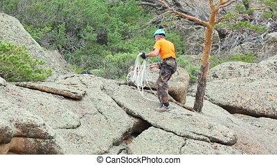 Rock climber - Climber preparing to descend the rock