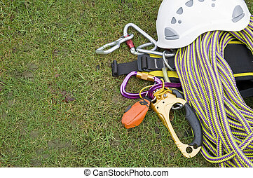 rock climbing equipment on grass
