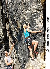 Rock climbing male instructor blond woman sunny - Rock ...