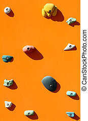 Rock climbing wall with toe and hand hold studs