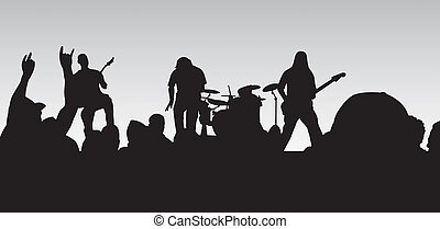 Rock Concert - Closeup concert silhouette of a four piece...