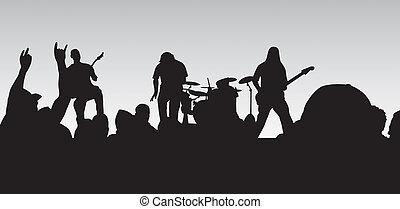 Rock Concert - Closeup concert silhouette of a four piece...