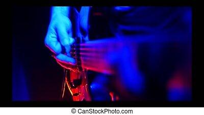 Guitarist plays on the illuminated lamps guitar - Rock...