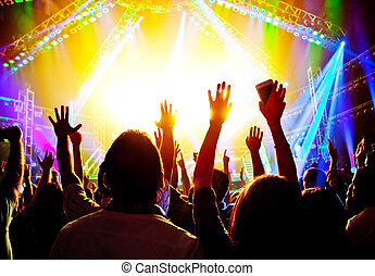 Rock concert, happy people silhouettes, raise up hands, ...