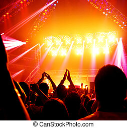 Image of rock concert, active people enjoying party, cheerful teens applauding to musician band, famous dj on the stage, new year celebration, night lifestyle, dancing nightclub, music festival