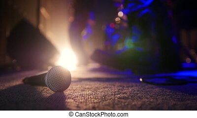 Microphone on the background of a rock band