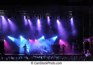 Rock concert on stage outside silhouette of singers on stage